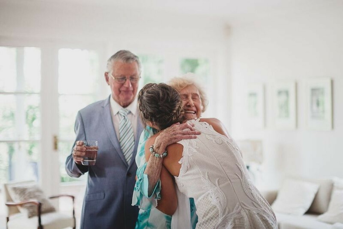 bride_hugs_for_grandma_and_grandpa.jpg