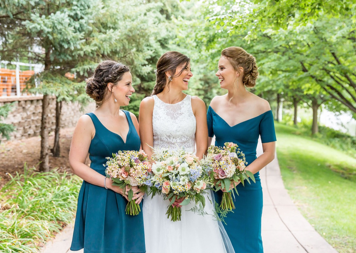 bride_laughing_with_bridesmaid_mismatched_teal.jpg