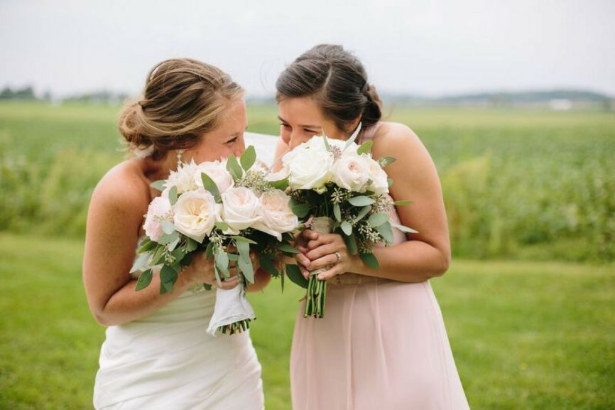bride_laughing_with_bridesmaid_wisconsin_wedding.jpg