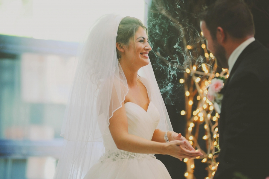 bride_laughing_with_groom_string_lights.jpg