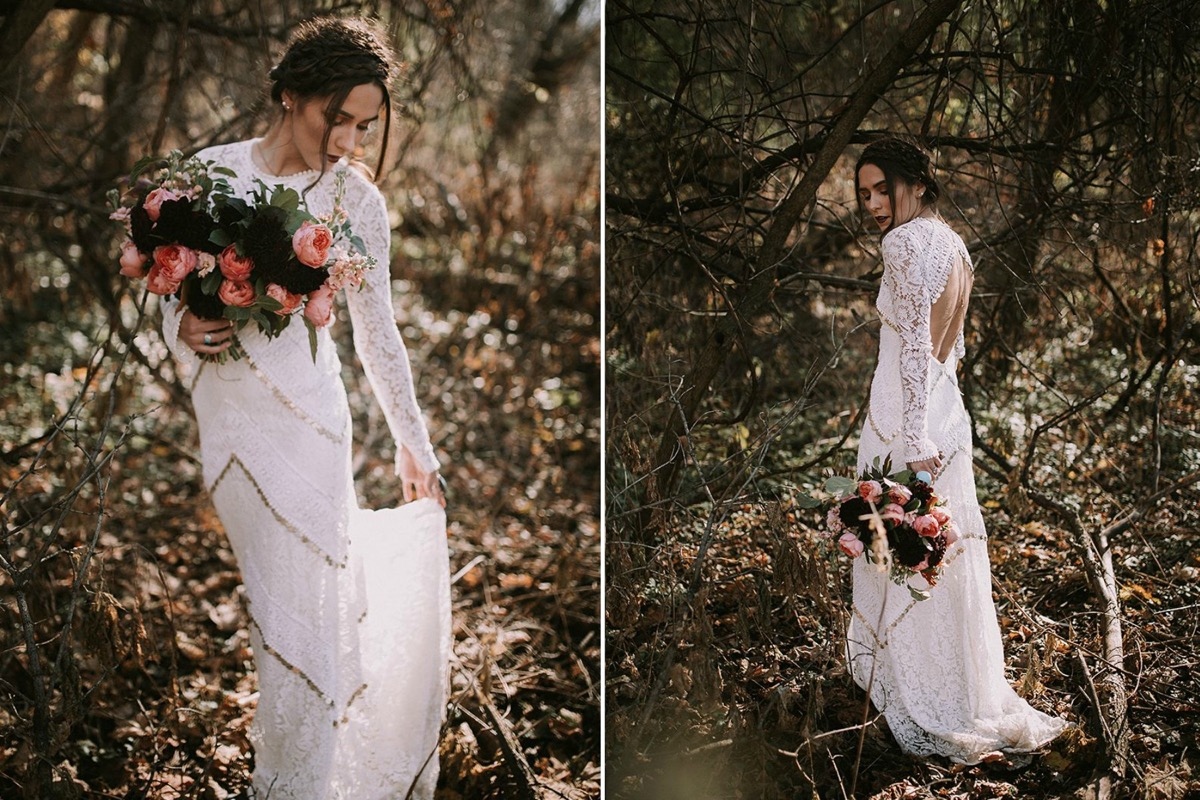bride_looking_down_at_lace_dress_with_gold_details.jpg