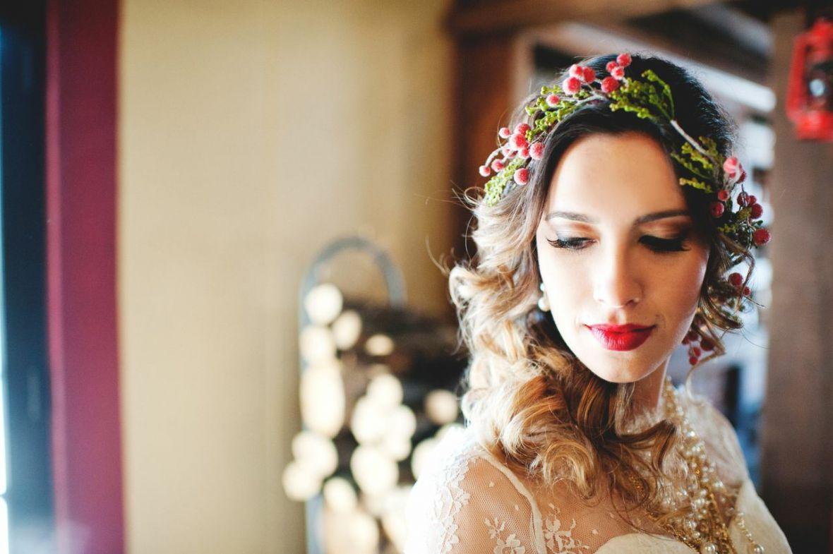 bride_looking_down_wearing_red_christmassy_flower_crown.jpg