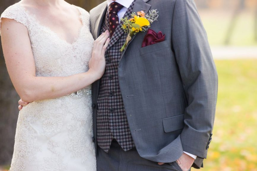 bride_placing_hand_on_grooms_chest_plaid_vest_thanksgiving.jpg