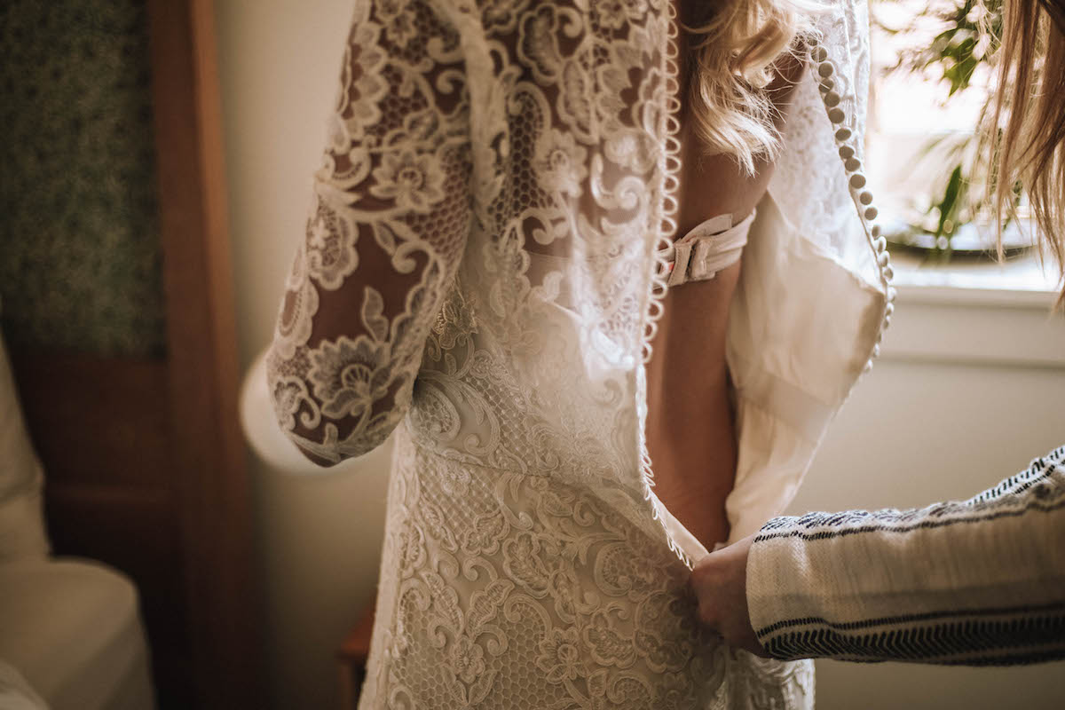 bride_putting_on_gown.jpg