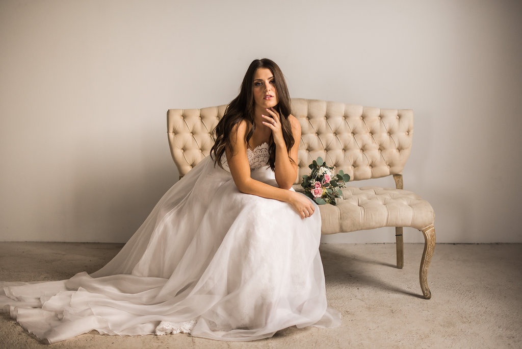 bride_sitting_on_tan_chair_serious_look.JPG