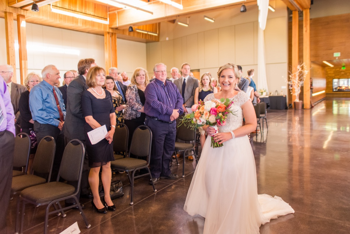 bride_smiling_walking_down_the_aisle_alone_.jpg