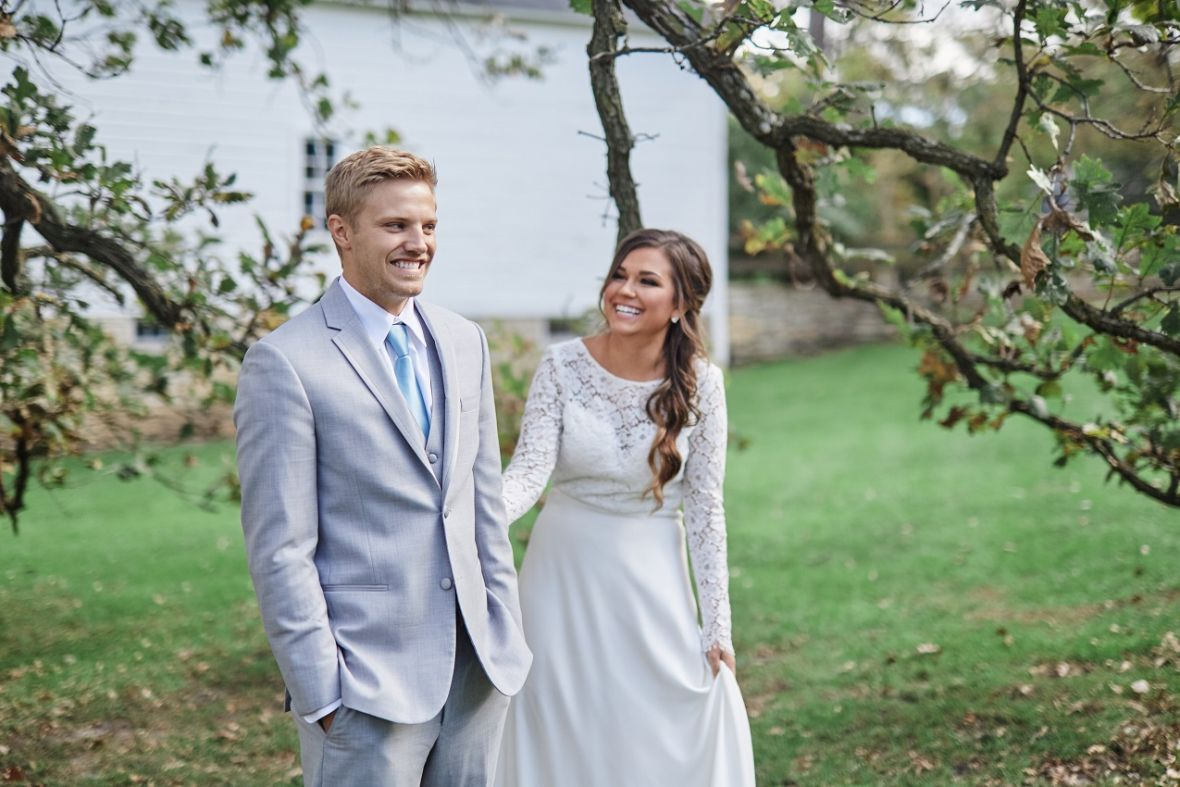 bride_tapping_on_grooms_arm_first_look_farm.jpg