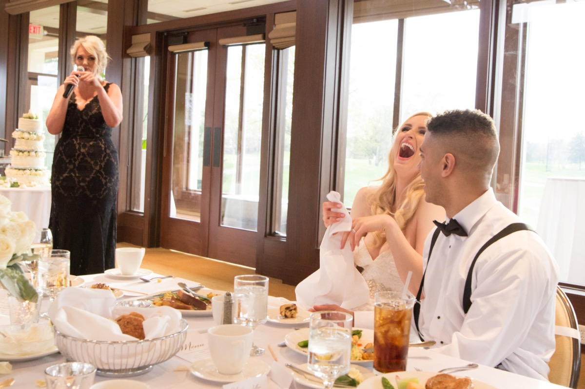 bride_throwing_head_back_laughing_wedding_speeches.jpg
