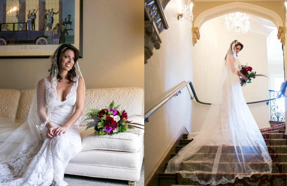 bride_wearing_cathedral_long_veil_lace_trimmings_posing_inside_classy_venue_on_stairs_underneath_white_chandelier.jpg