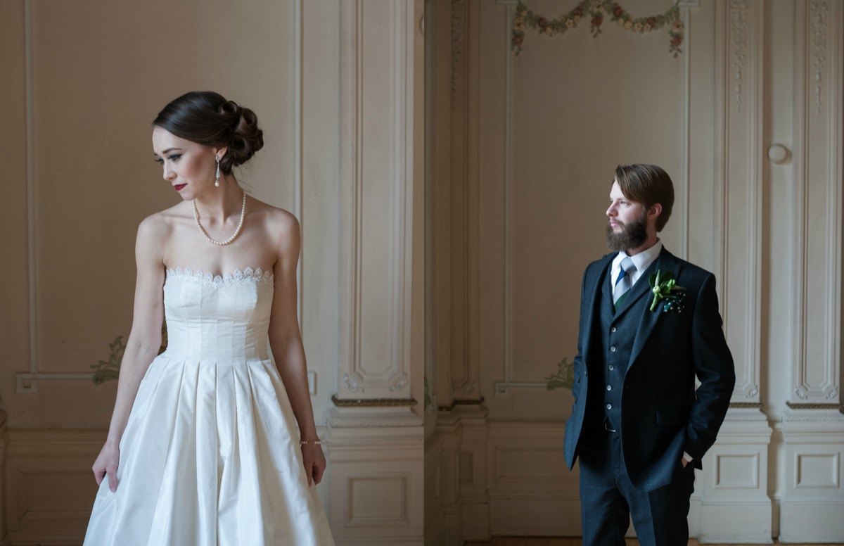bride_wearing_satin_dress_pearl_earrings_necklace_groom_navy_tux_green_boutineer.jpg