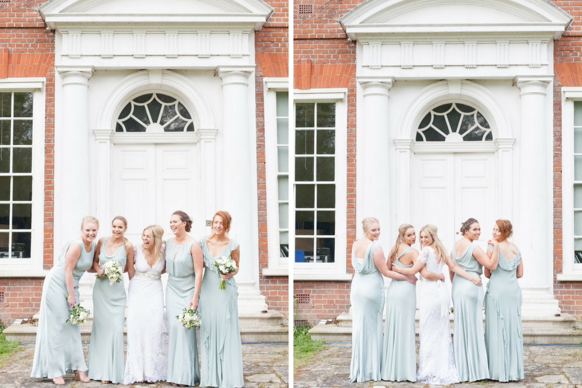 bride_with_bridesmaids_linking_arms_in_front_of_classic_brick_building_white_pillars.jpg