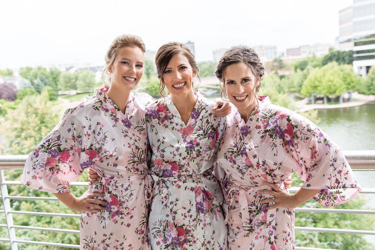 bride_with_bridesmaids_pink_purple_floral_robes.jpg