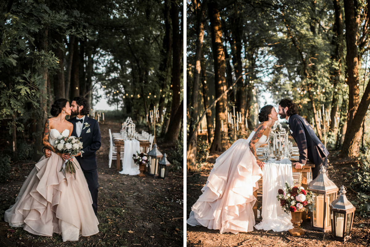 bride_with_sleeve_tattoo_and_groom_kissing_laughing_over_dinner_table_in_sunny_forest.jpg