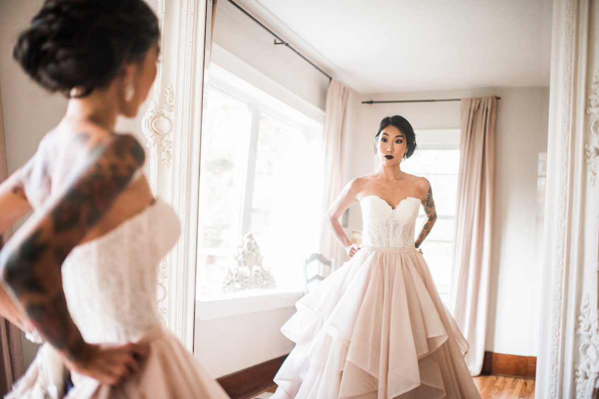 bride_with_sleeve_tattoo_pink_white_wedding_gown.jpg