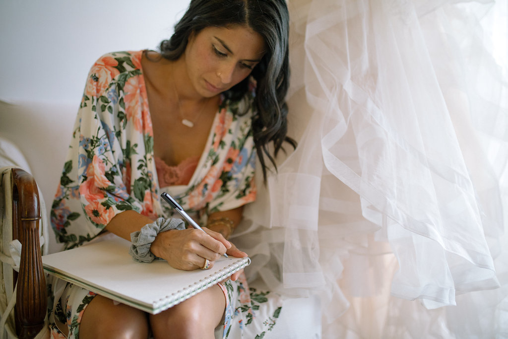 bride_writing_letter_-_floral_robe_-_california-_simply_gypsy_events_-_cecily_breeding.jpg