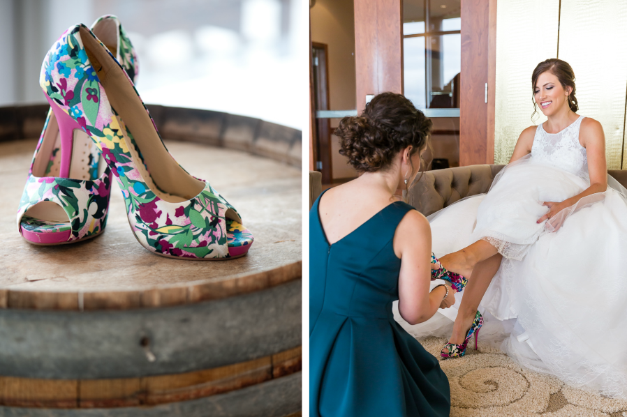 bridesmaid_putting_brides_shoes_on_magenta_floral_heels.png