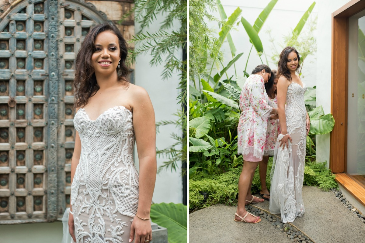 bridesmaids_buttoning_brides_dress_outdoors_by_palm_leaves.jpg