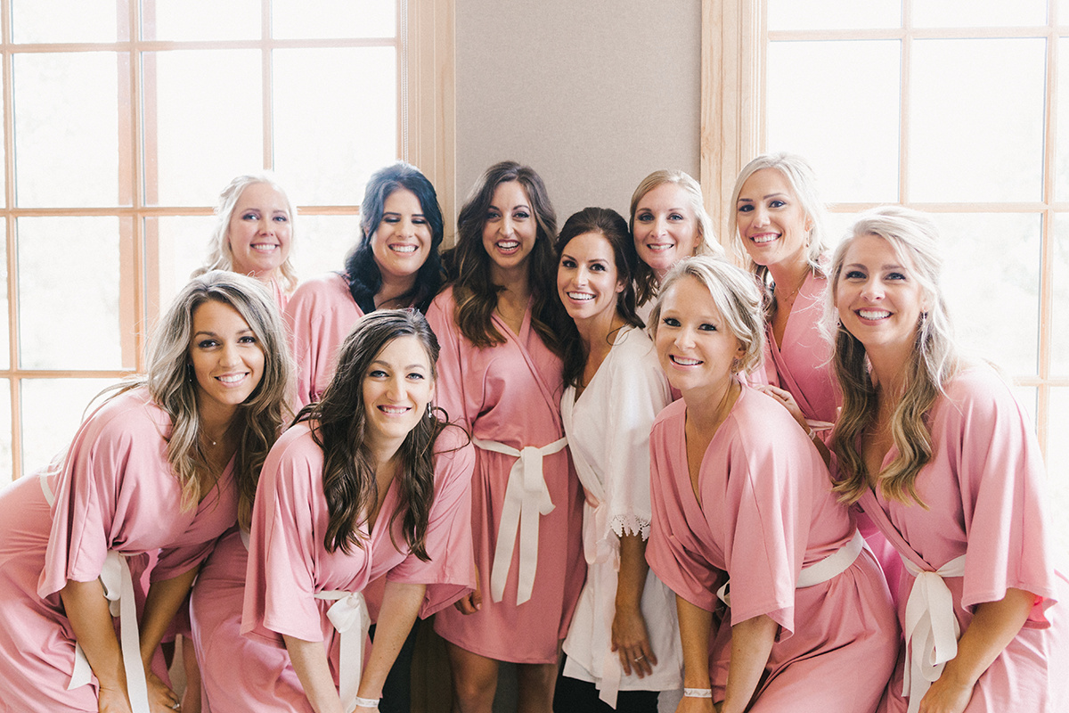 bridesmaids_pink_robes_white_sash.jpg