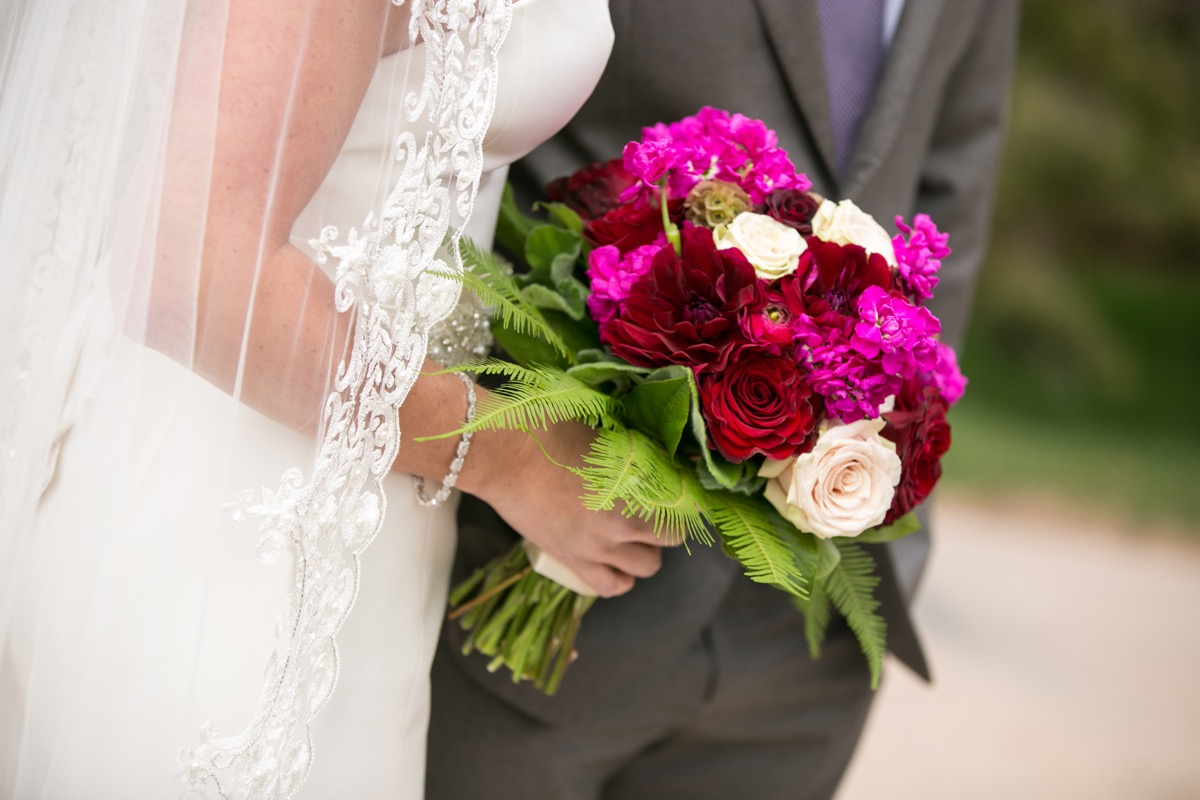 bright_pink_red_blush_bouquet_inspiration_ideas_with_a_little_bit_of_greenery_purple_tie_gray_tux.jpg