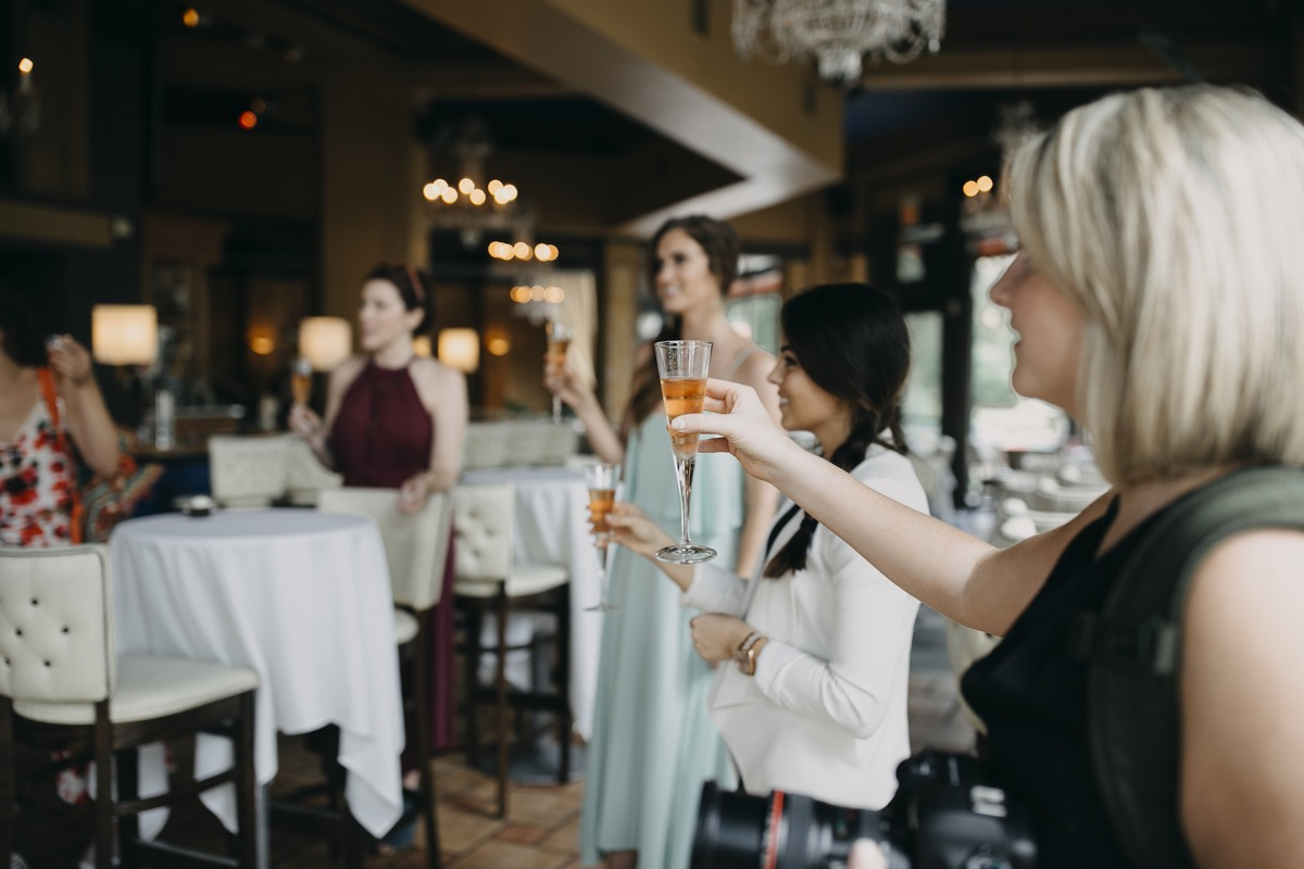 champagne_toast_cheers_end_of_styled_shoot.jpg
