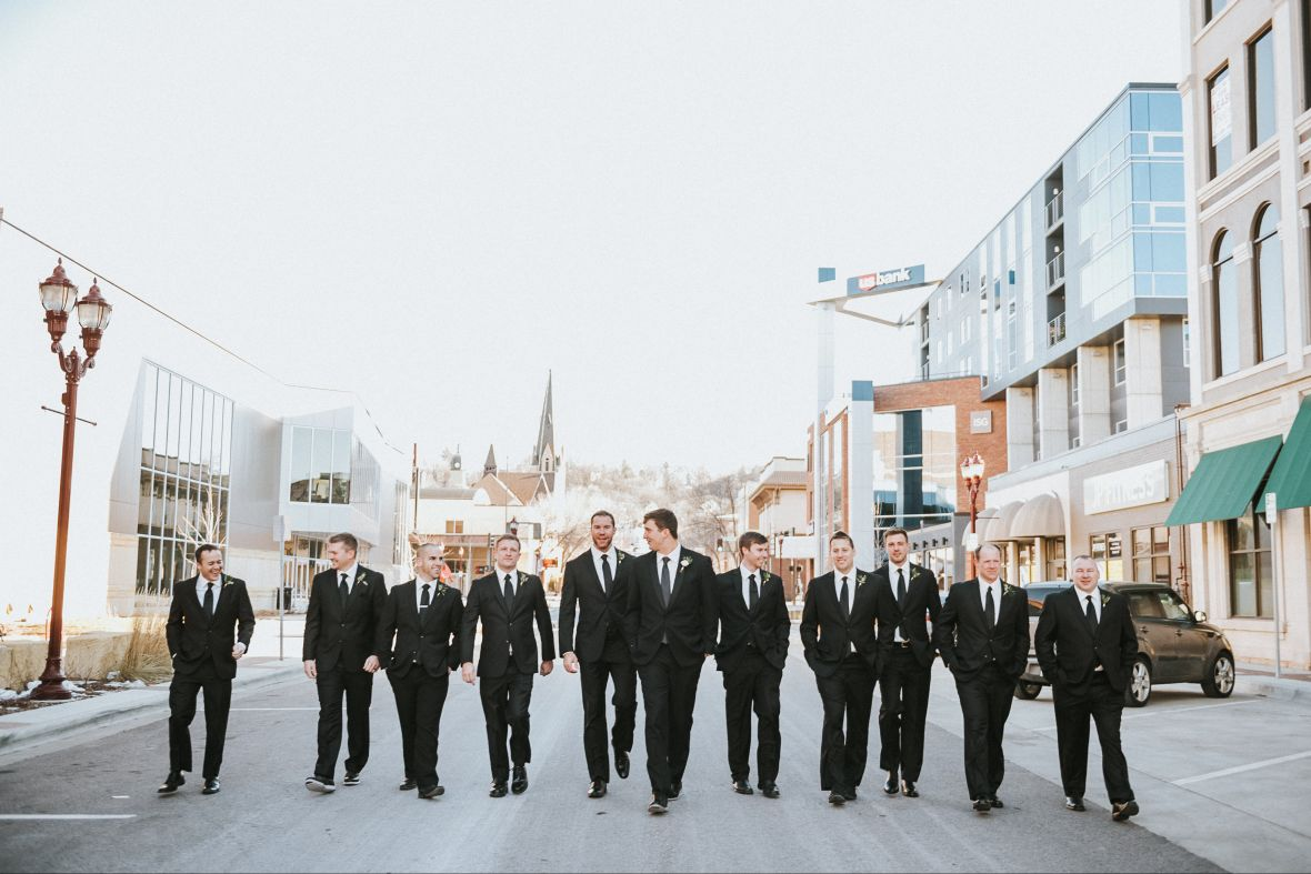 classy_groomsmen_walking_in_street_matching_black_suits.jpg