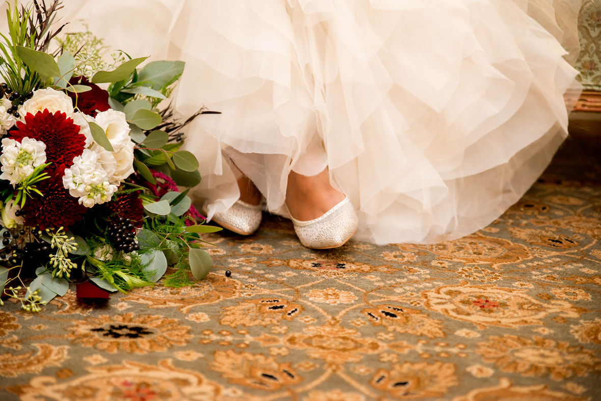 close-up-of-shoes-dress-and-florals.jpg