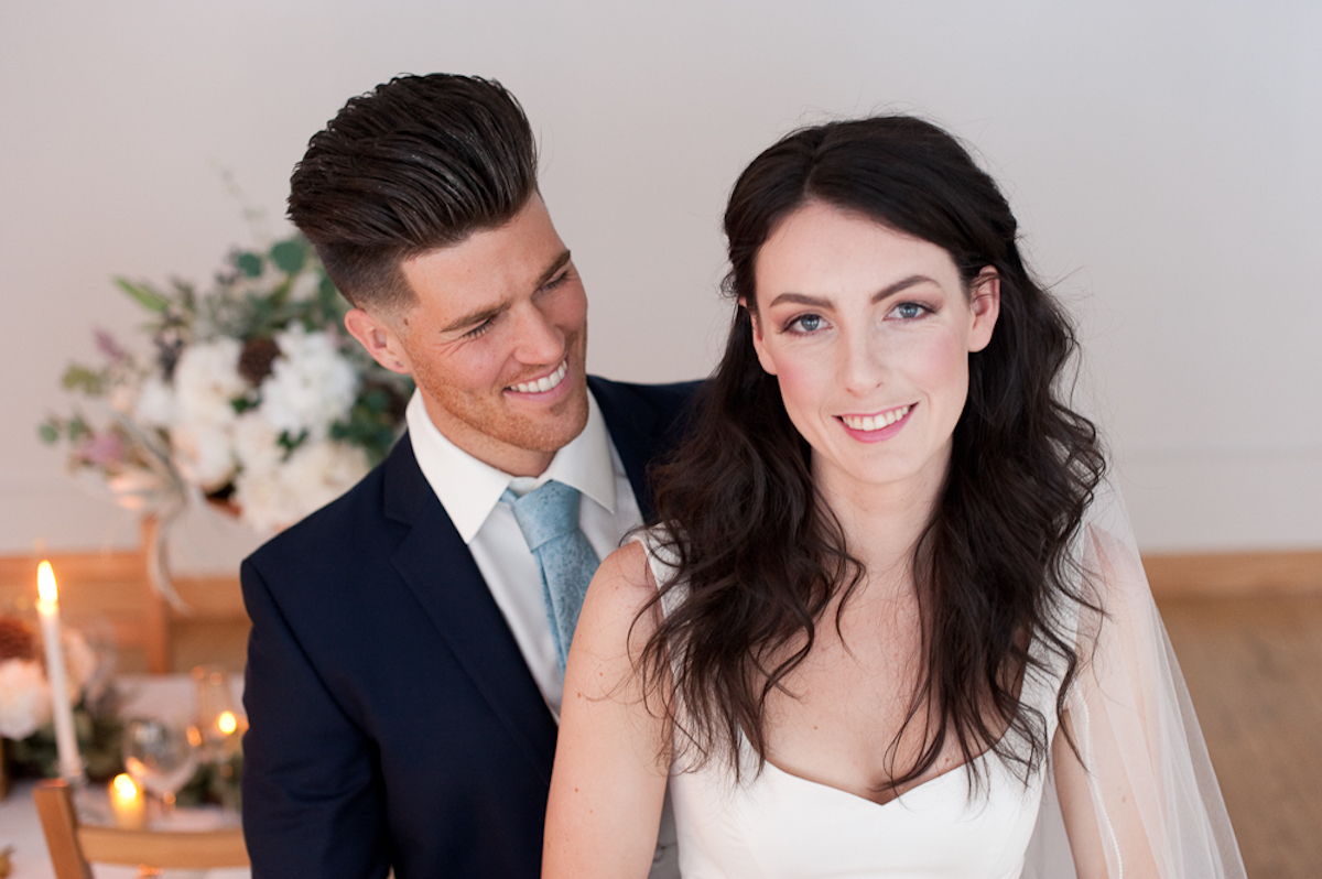 close_up_bride_and_groom_laughing.jpg