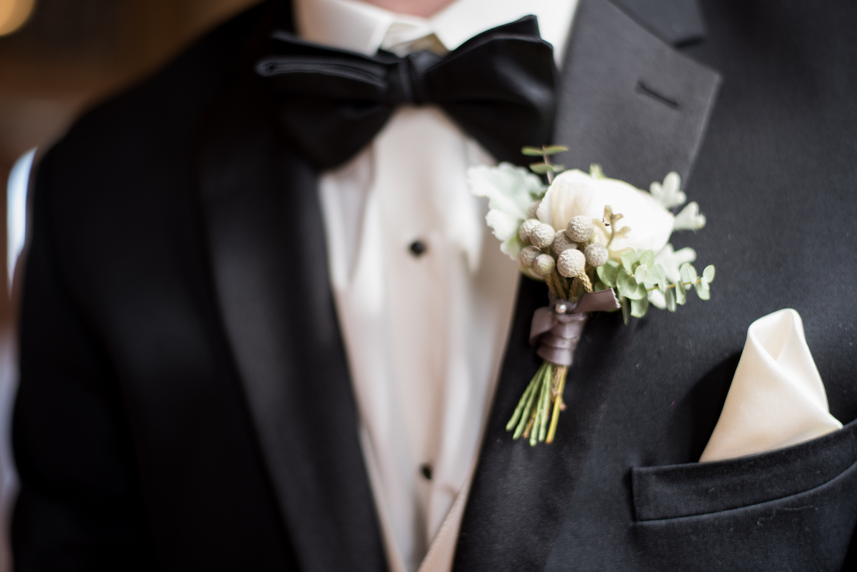 close_up_details_of_grooms_green_boutonniere.jpg