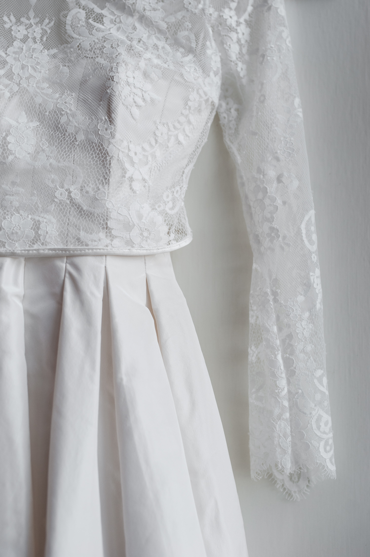 close_up_of_vintage_long_sleeve_lace_wedding_gown.jpeg