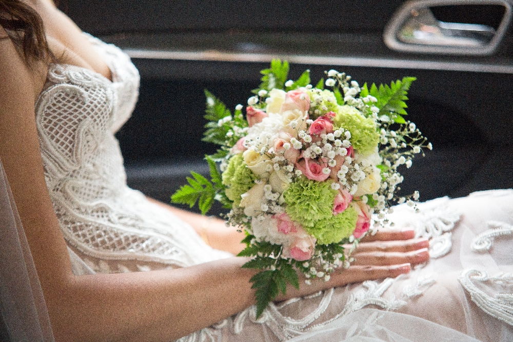 closeup_of_bride_holding_pink_bouquet_on_lap.jpg