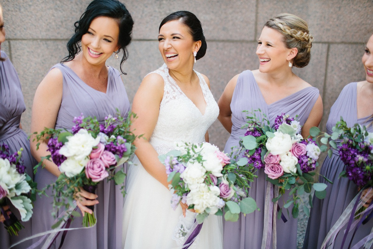 closeup_of_bride_laughing_with_pregnant_bridesmaids.jpg