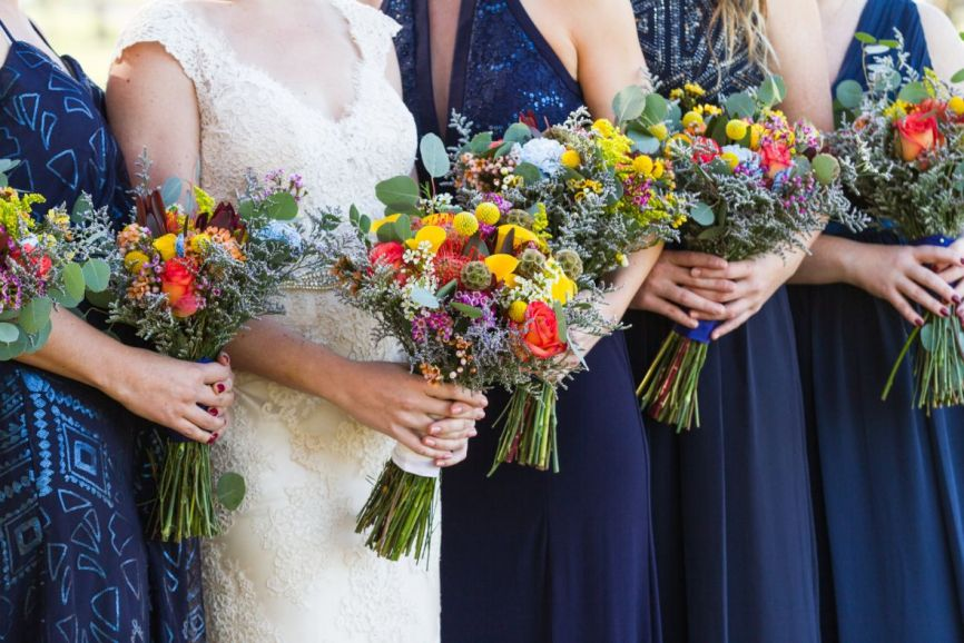 closeup_of_bright_unique_bouquets_yellow_red_navy.jpg