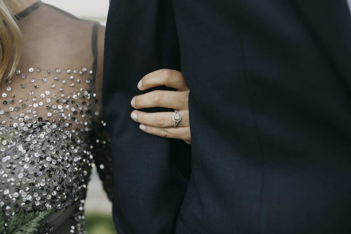 closeup_of_engagement_ring_linked_in_mans_arm.jpg