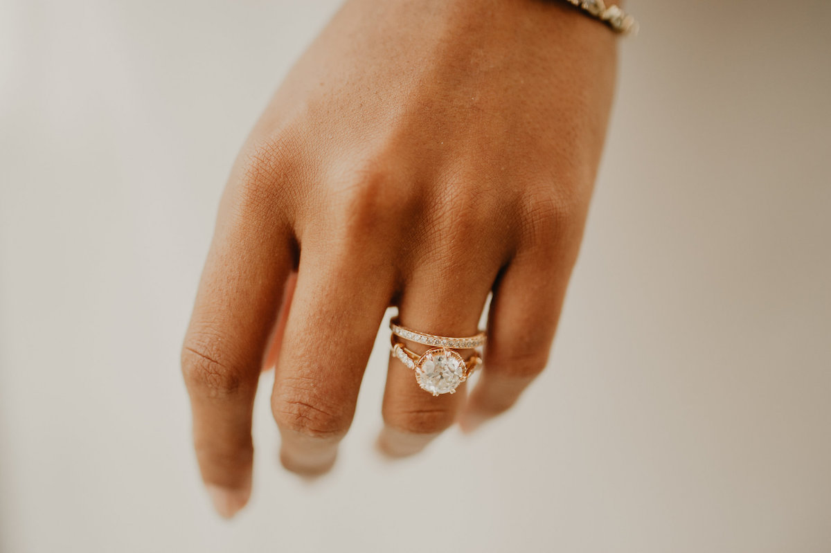 closeup_of_hand_rose_gold_engagement_ring.jpg