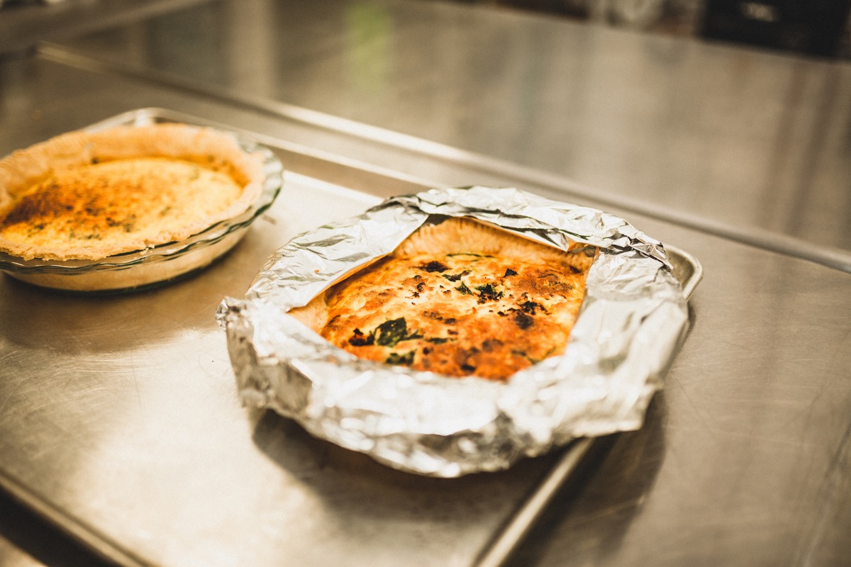 closeup_of_quiche_in_pan_on_silver_counter.jpg
