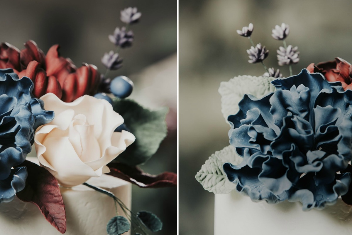 closeup_romantic_wedding_cake_flowers_blue_pink_red.jpg
