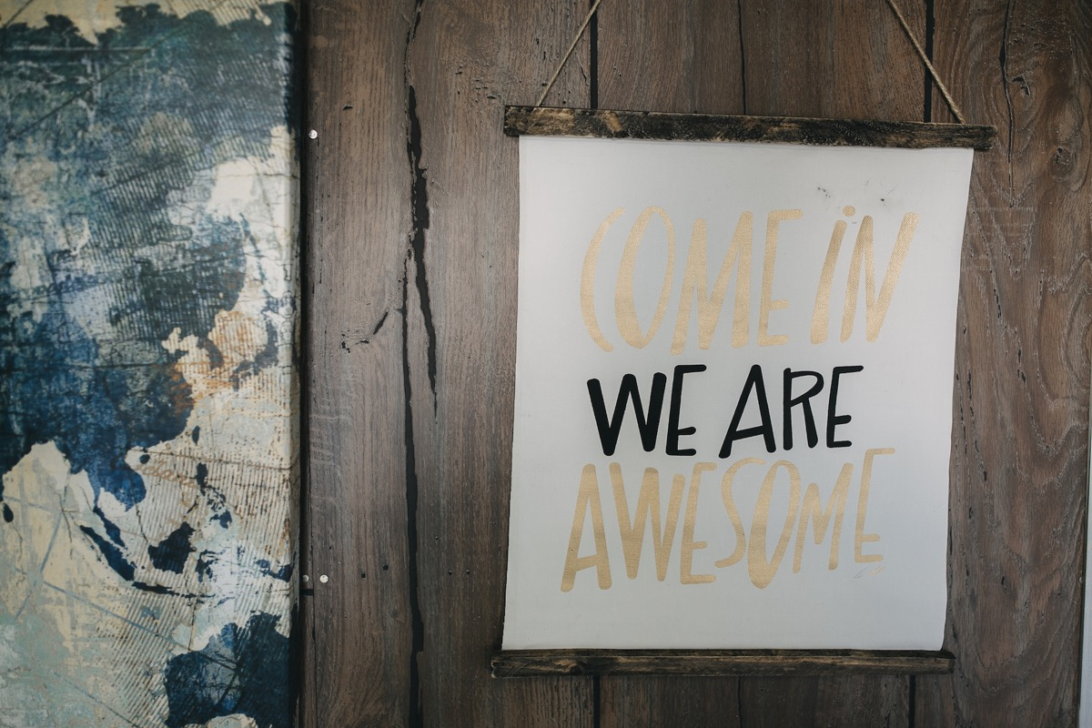 come_in_we_are_awesome_sign_vintage_camper_photo_booth.jpg