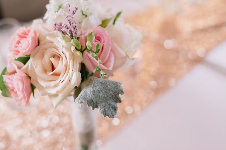 coral_pink_blush_bouquets_on_gold_sequin_table_runner.jpg