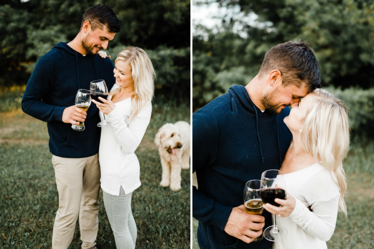 couple_cheers_with_wine_glasses_outdoor_engagement_photos.jpg