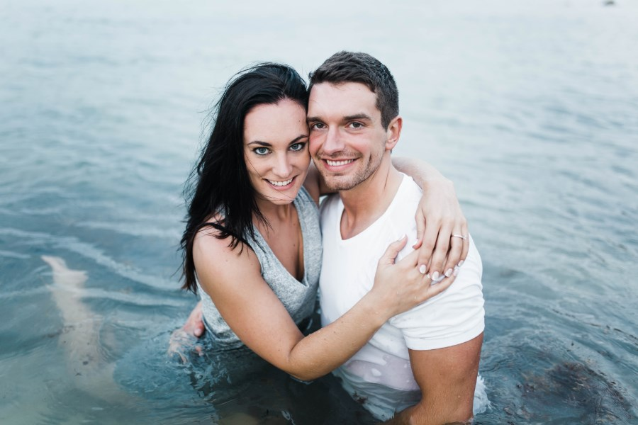 couple_engagement_photos_sitting_in_mexico_water.jpg