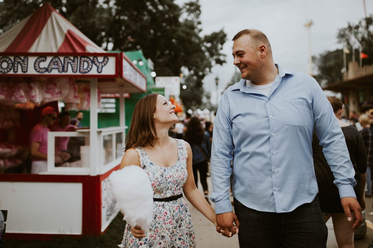 couple_holding_hands_cotton_candy_state_fair.jpg
