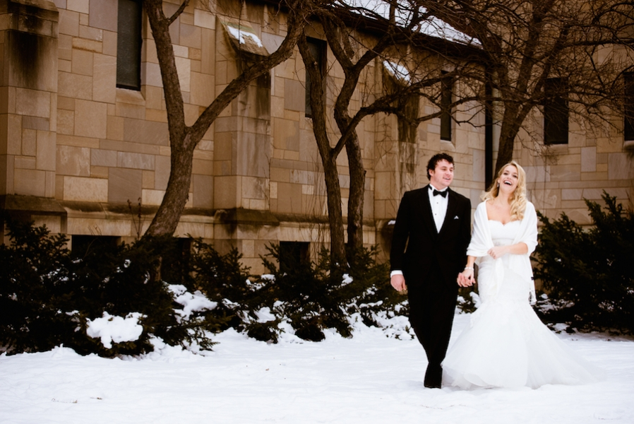 couple_holding_hands_in_snow_outside_stone_church_snow.jpg
