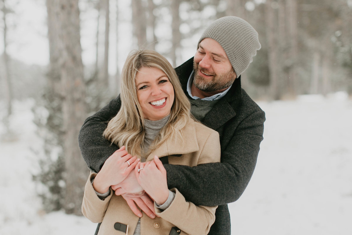 couple_hugging_and_laughing_in_winter_forest.jpg