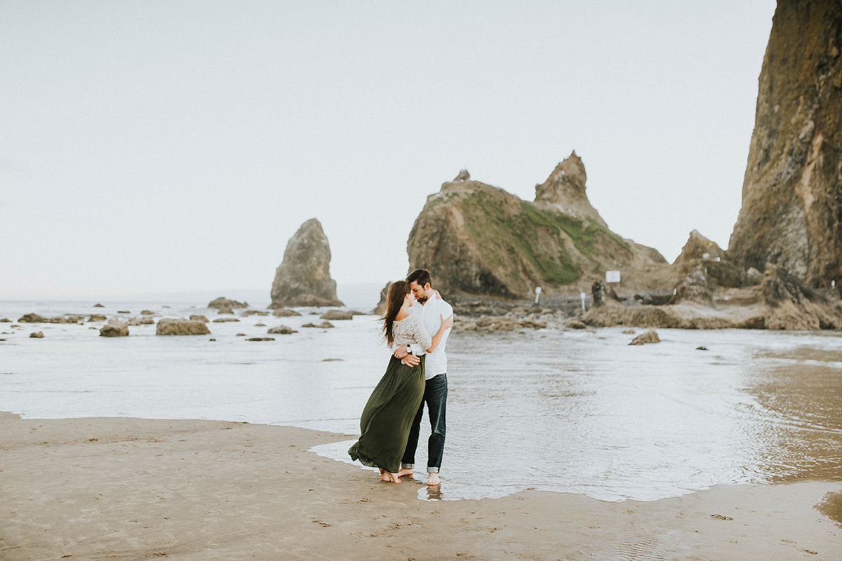 couple_hugging_on_beach_oregon_coast.jpg