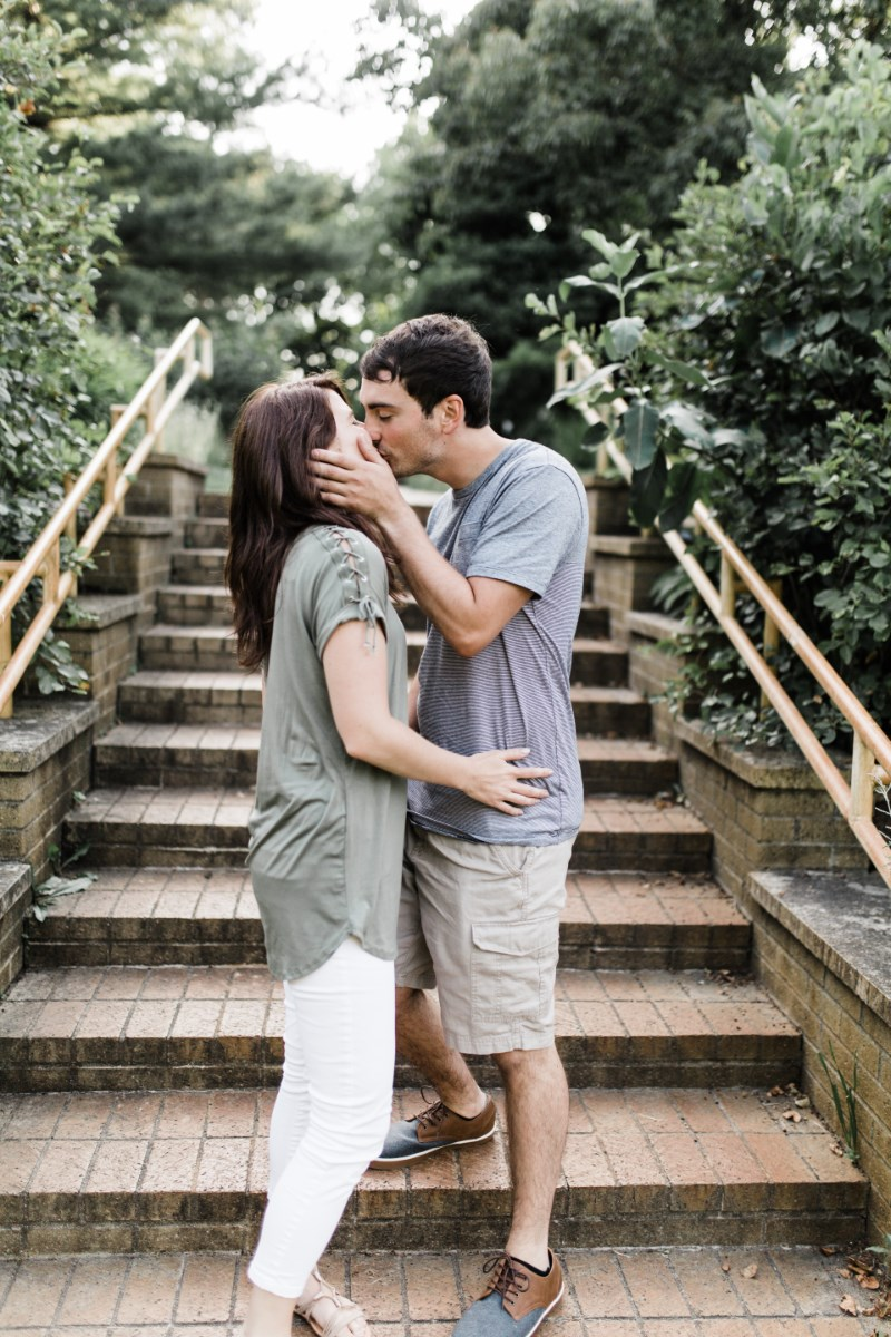 couple_kissing_by_steps_standing.jpg