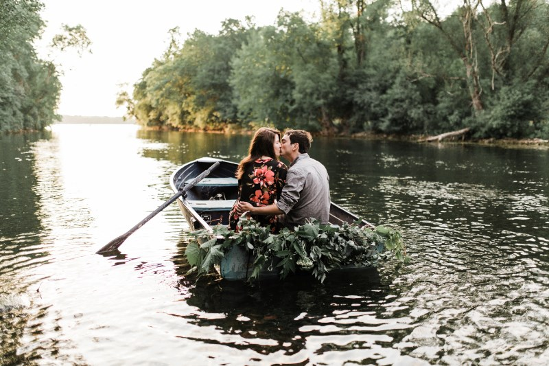 couple_kissing_in_boat_floral_dress_trees.jpg