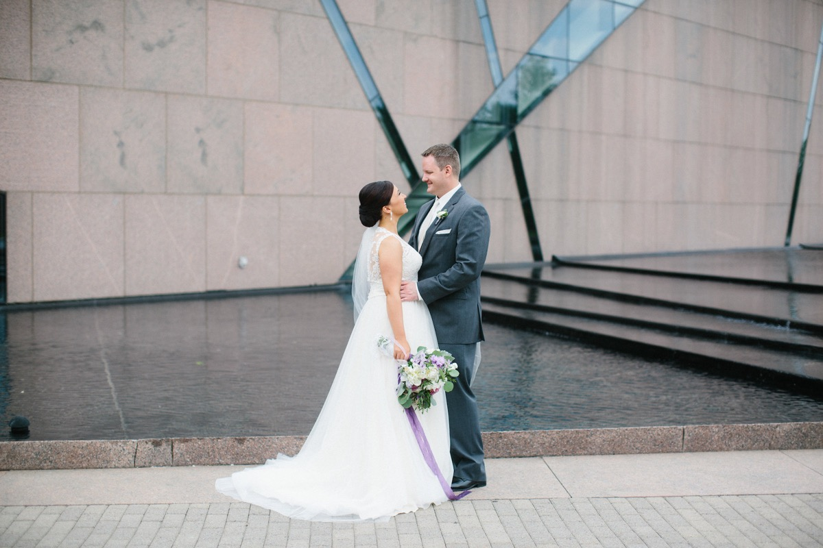 couple_looking_at_each_other_smiling_mcnarama_wedding_venue.jpg