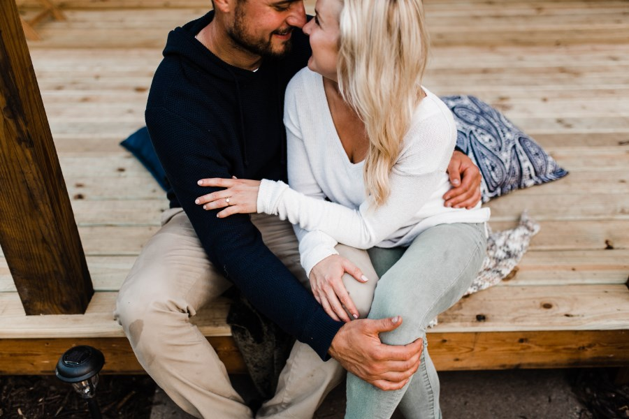 couple_sitting_on_wooden_steps_embracing.jpg
