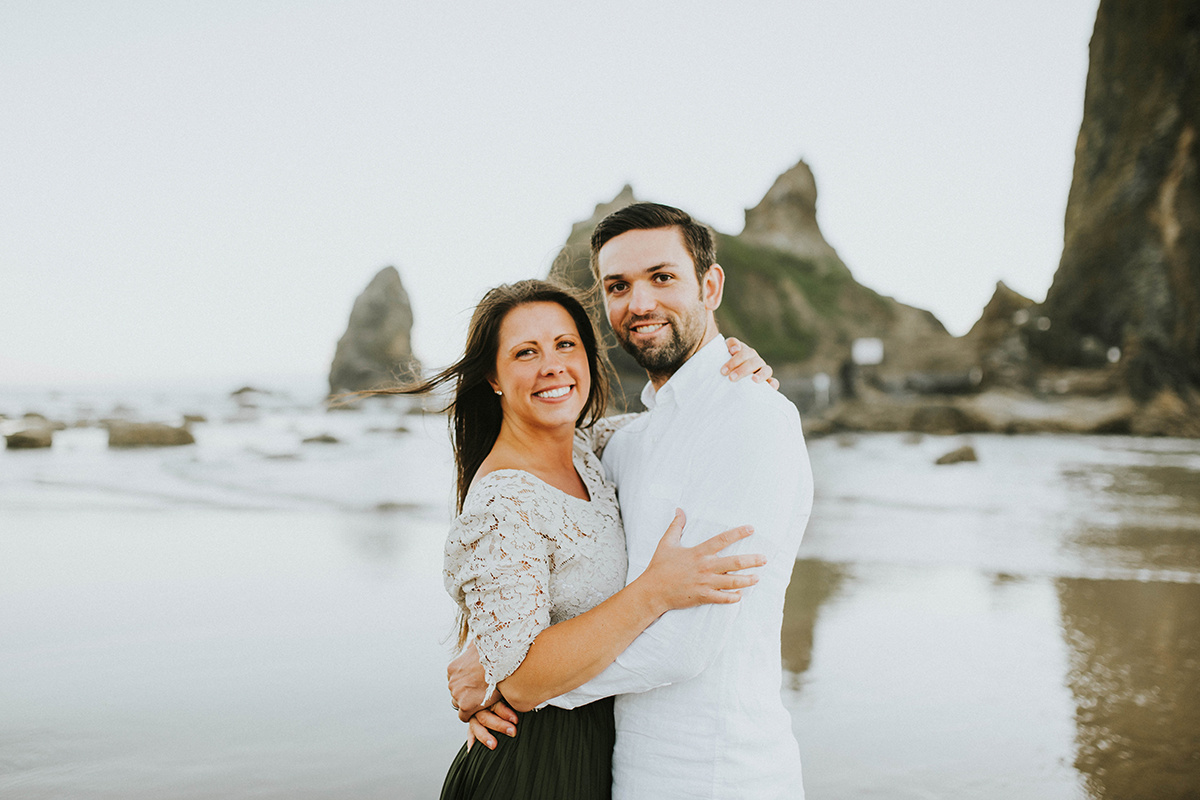 couple_smiling_at_camera_embracing_hug_beach.jpg