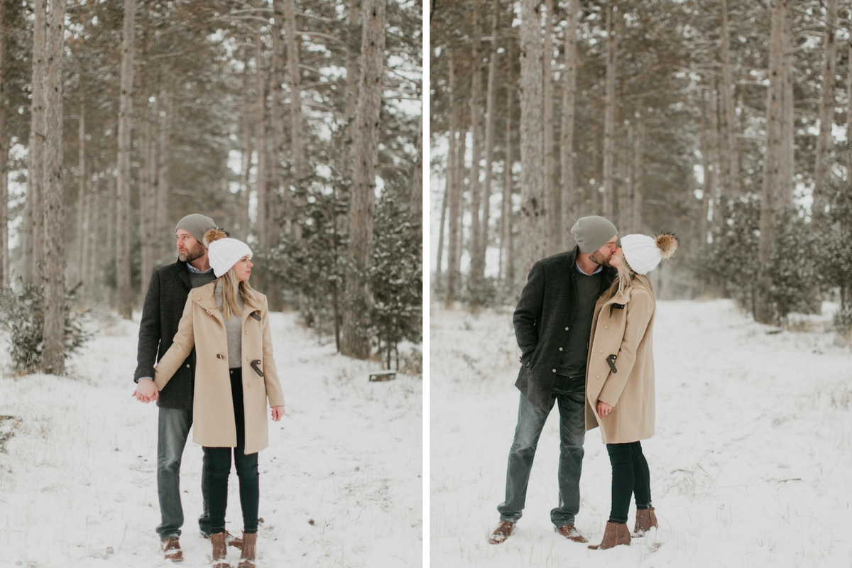 couple_standing_kissing_at_snowy_tree_farm.jpg